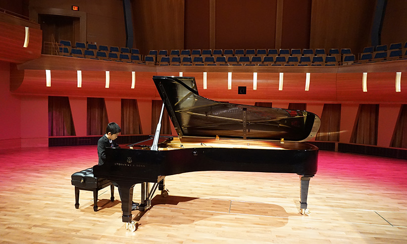 Kevin Chen performing at the Mount Royal University Bella Concert Hall in August, 2015. Kevin was the only pianist invited to play at the Grand Opening. (Matthew Chen)
