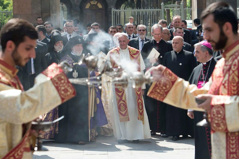 Pope Francis, center, and Catholicos Karekin II arrive to visit the Apostolic Cathedral of Etchmiadzin, Yerevan, Armenia, Friday, June 24, 2016. Pope Francis is in Armenia for a three-day visit.(L'Osservatore Romano/Pool Via AP)