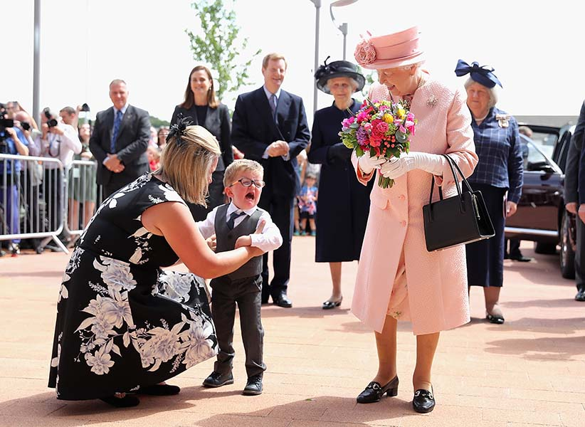Two year old Lewis Connet bursts into tears as he presents Queen Elizabeth II with flowers as she arrives with the Duke of Edinburgh to officially open Alderhey Children's Hospital during a visit to Liverpool on June 22, 2016 in Liverpool, England. (Chris Jackson/Getty Images)