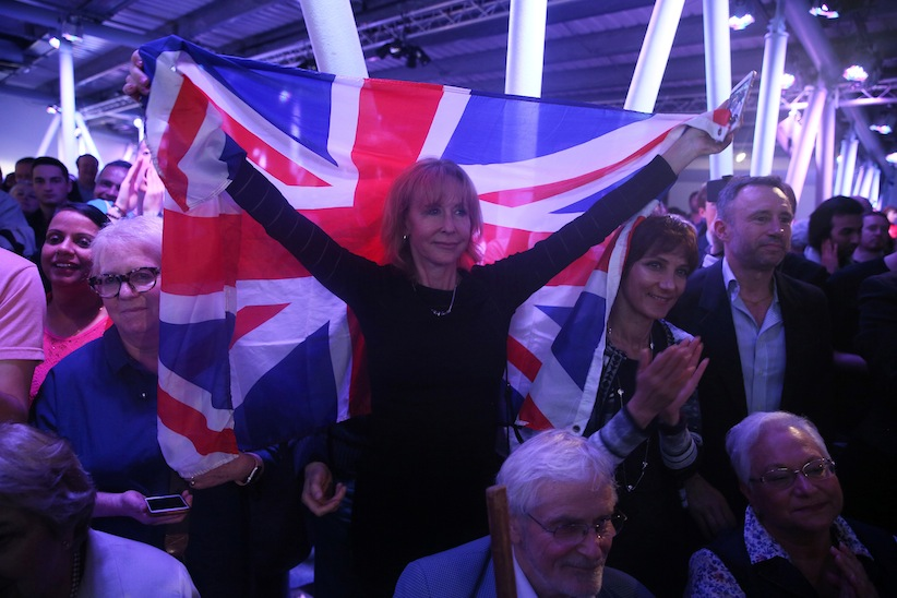 A Brexit supporter holds a Union Flag at a Vote Leave rally in London, Britain June 4, 2016. (Neil Hall/Reuters)