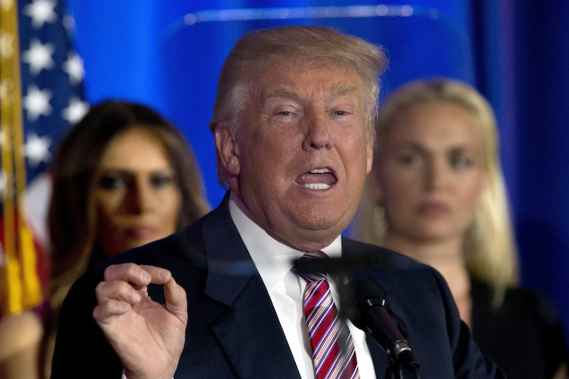 Republican presidential candidate Donald Trump is seen through the teleprompter as he speaks at the Trump National Golf Club Westchester, Tuesday, June 7, 2016, in Briarcliff Manor, N.Y. (AP Photo/Mary Altaffer)