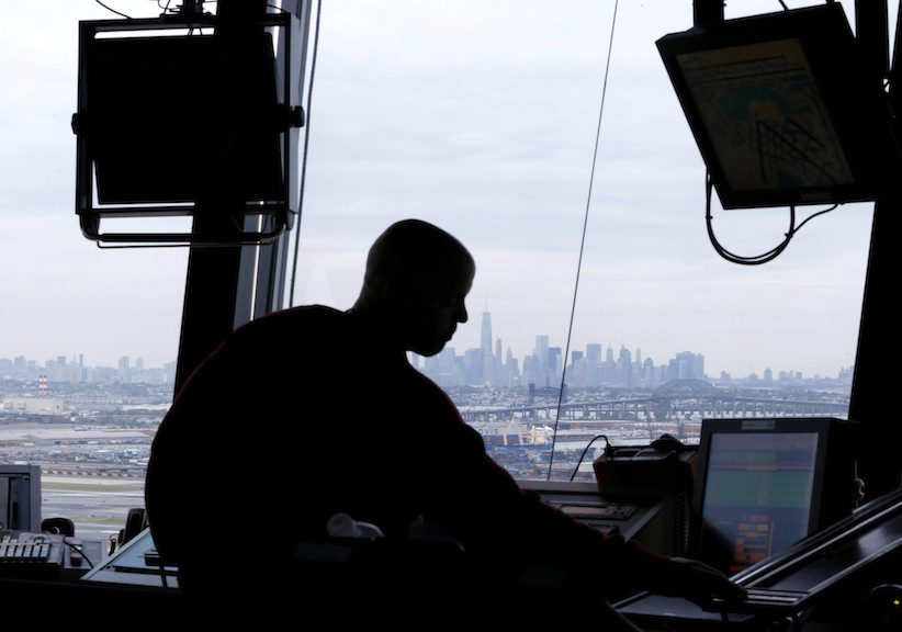 In this May 21, 2015 file photo, an air traffic controller works in the tower at Newark Liberty International Airport in Newark, N.J. ( AP Photo/Julio Cortez, File)