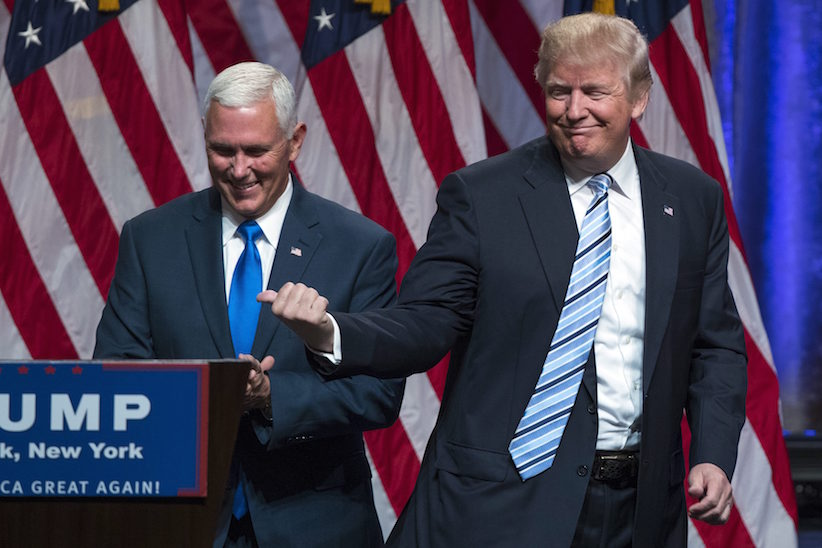 "Republican presidential candidate Donald Trump, right, introduces Gov. Mike Pence, R-Ind., during a campaign event to announce Pence as the vice presidential running mate on, Saturday, July 16, 2016, in New York.   Trump called Pence ""my partner in this campaign"" and his first and best choice to join him on a winning Republican presidential ticket.   (AP Photo/Evan Vucci)"