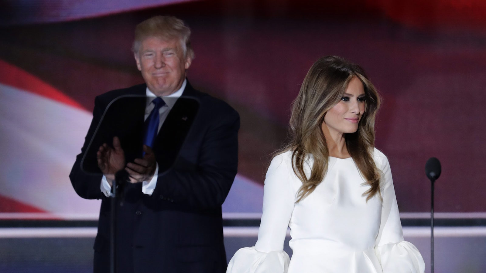 Melania Trump, wife of Republican Presidential Candidate Donald Trump walks to the stage as Donald Trump applaudss during the opening day of the Republican National Convention in Cleveland, Monday, July 18, 2016. (AP Photo/J. Scott Applewhite)