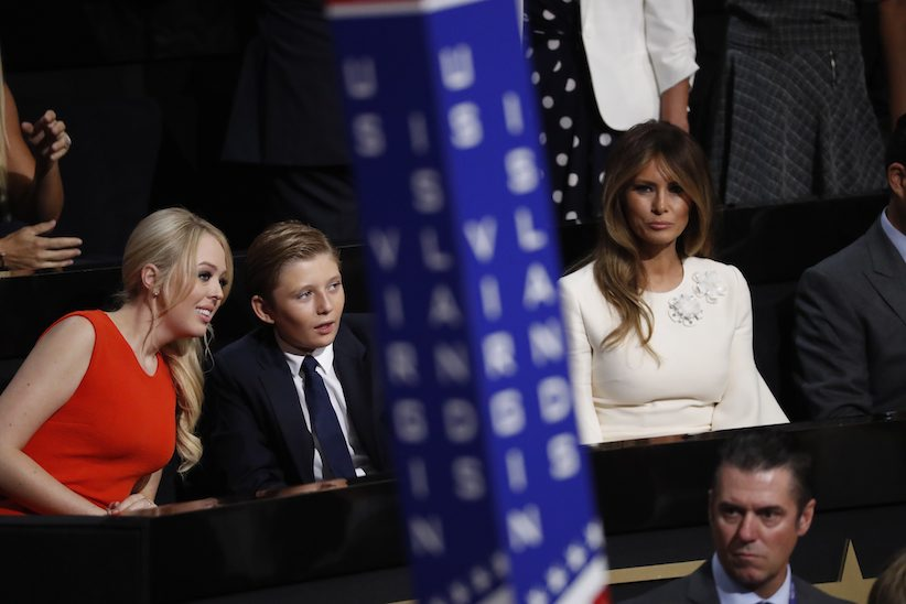 Barron Trump, center, so of Donald and Melania Trump, talks to Tiffany Trump as Melania Trump sits at right during the final day of the Republican National Convention in Cleveland, Thursday, July 21, 2016. (AP Photo/Paul Sancya)