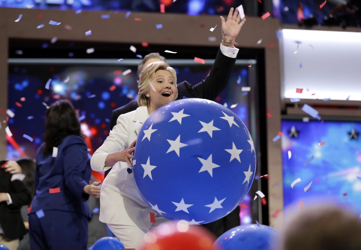 Democratic presidential nominee Hillary Clinton throws a balloon after speaking to there delegates during the final day of the Democratic National Convention in Philadelphia, Thursday, July 28, 2016. (AP Photo/Matt Rourke)