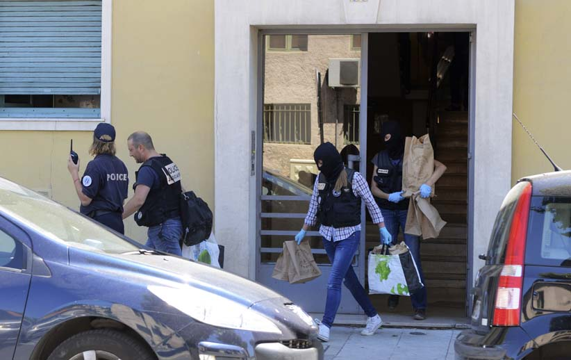 French investigating police carry evidence bags after they conducted a search at the apartment and a truck, the day after a heavy a truck ran into a crowd at high speed killing scores and injuring more who were celebrating the Bastille Day national holiday, in Nice, France, July 15, 2016. (Jean-Pierre Amet/Reuters)