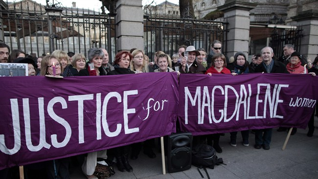 Relatives of victims of the Magdalene Laundries hold a candle lit vigil in solidarity with Justice for Magdalene Survivors and their families outside Leinster House in Dublin, Ireland, on Feb. 19, 2013. THE CANADIAN PRESS/AP, Peter Morrison