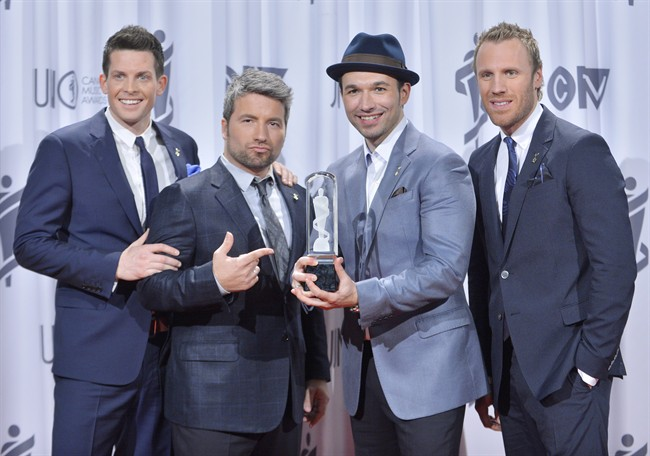 The Tenors pose with the Juno after winning for Adult Contemporary Album of the Year during the 2013 Juno Gala, Dinner and Awards in Regina on Saturday, April 20, 2013. The Tenors changed some of the lyrics of O Canada as they made a political statement while singing the national anthem at Tuesday night's MLB all-star game. (Liam Richards/CP)
