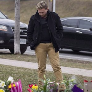 Michael Ford, the nephew of the late Rob Ford, looks at the flowers left at Douglas.B Ford Park in Etobicoke, on Wednesday, March 23, 2016. Former Toronto Mayor Rob Ford's legacy will be put to the test on Monday as voters choose who will inherit the late politician's west-end ward at the heart of so-called Ford Nation. THE CANADIAN PRESS/Chris Young