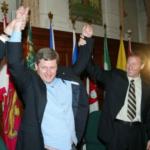 Conservative Party Leader Stephen Harper is welcomed by Conservative Party member Peter MacKay before they start a meeting with their new caucus in Ottawa on Wednesday July 7, 2004. Harper received long, loud applause Wednesday as he met with his new 99-member national caucus for the first time since the June 28 election. (Fred Chartrand/CP)