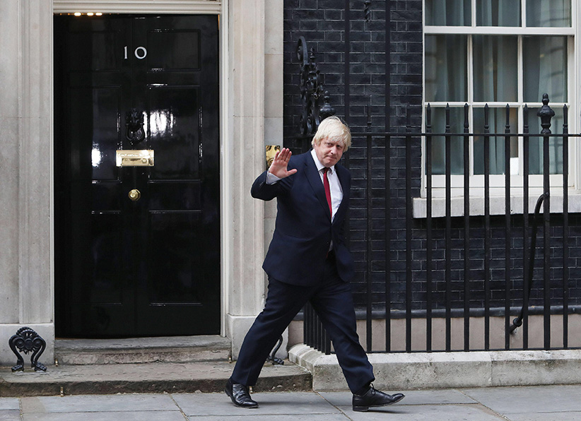 Boris Johnson leaves 10 Downing Street after being appointed Foreign Secretary, following a Cabinet reshuffle by new Prime Minister Theresa May, in London, Wednesday, July 13, 2016. (Steve Parsons/AP)