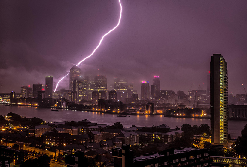 Massive Lightning strike over Canary Wharf business park buildings and River Thames (Guy Corbishley/Alamy)