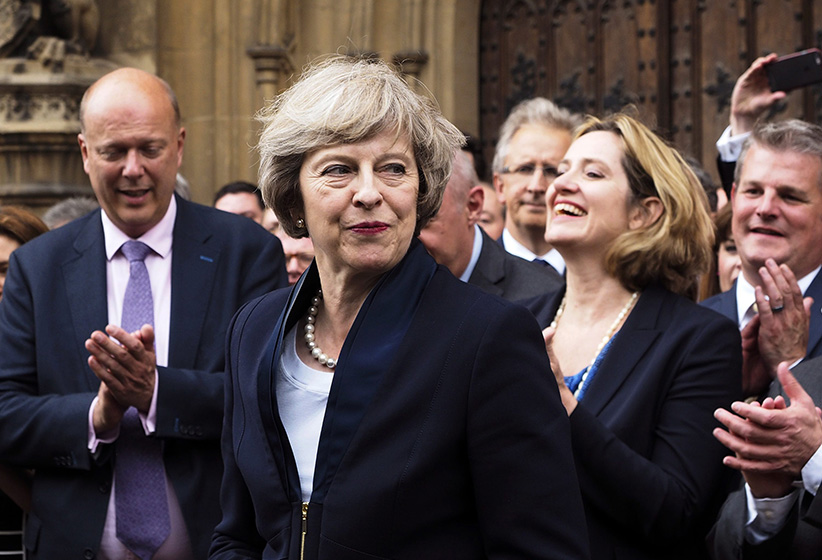 "Britain's Theresa May is applauded by Conservative Party members of parliament outside the Houses of Parliament in London, Monday July 11, 2016. Britain's Conservative Party has confirmed that Theresa May has been elected party leader ""with immediate effect"" and will become the country's next prime minister. Prime Minister David Cameron has said he will step down on Wednesday July 13, 2016 and May will immediately replace him. (Max Nash/AP)"