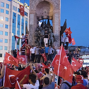 "The day after a failed coup attempt in Turkey, supporters of President Recep Tayyip Erdogan and his AK Party gather at Taksim Square for a ""Democracy festival"", climbing onto the iconic monument of Mustafa Kemal Ataturk, modern Turkey's founder.   The fallout from the failed coup has left Turkey more divided than ever between Islamists and secularists. (Photograph by Adnan Khan)"