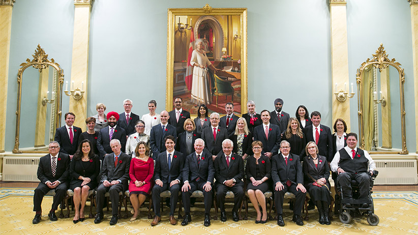 Newly elected Canadian Prime Minister Justin Trudeau, fifth left first row, takes a group photo with his cabinet ministers at Rideau Hall in Ottawa, Canada, Nov. 4, 2015. Justin Trudeau was sworn in as Canada's 23rd prime minister and named a 31-member cabinet here Wednesday. (Chris Roussakis/Xinhua News Agency/Getty Images)