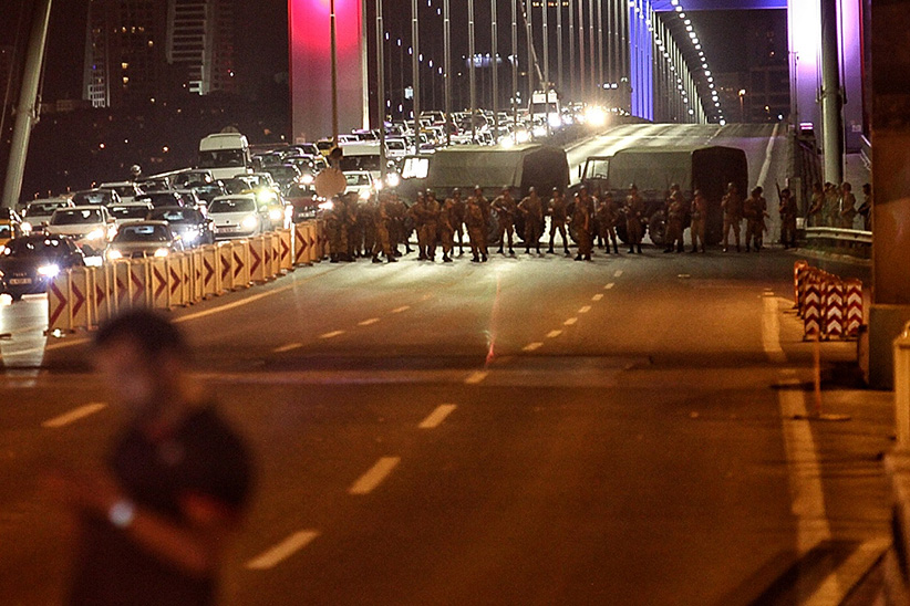 "Turkish soldiers block Istanbul's Bosphorus Bridge on July 15, 2016 in Istanbul, Turkey. Istanbul's bridges across the Bosphorus, the strait separating the European and Asian sides of the city, have been closed to traffic. Reports have suggested that a group within Turkey's military have attempted to overthrow the government. Security forces have been called in as Turkey's Prime Minister Binali Yildirim denounced an ""illegal action"" by a military ""group"", with bridges closed in Istanbul and aircraft flying low over the capital of Ankara. (Gokhan Tan/Getty Images)"
