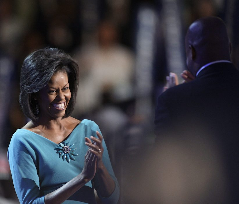 Craig Robinson, right, greets his sister Michelle Obama, wife of Democratic presidential candidate, Sen. Barack Obama, D-Ill., to the Democratic National Convention in Denver, Monday, Aug. 25, 2008. (AP Photo/Paul Sancya)