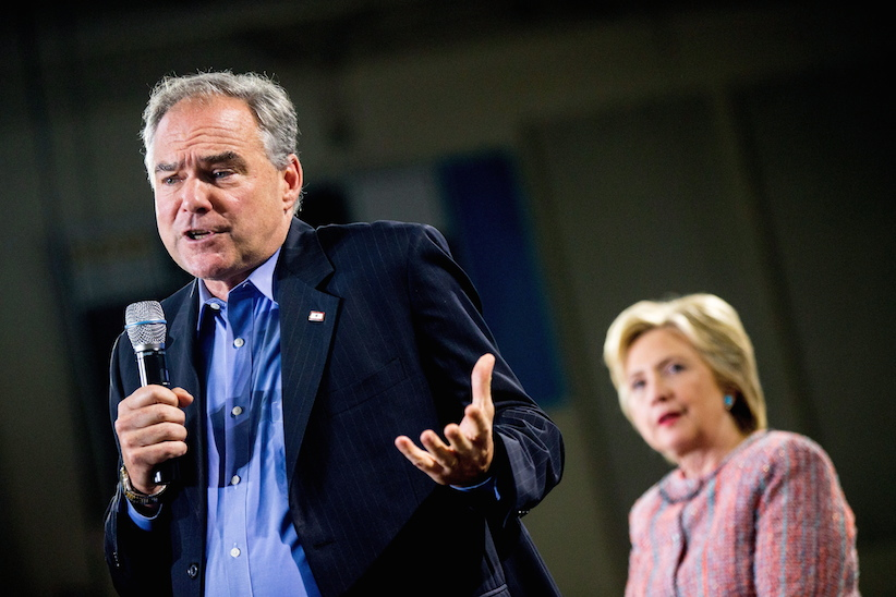 Democratic presidential candidate Hillary Clinton, right, listens as Sen. Tim Kaine, D-Va., speaks at a rally at Northern Virginia Community College in Annandale, Thursday, July 14, 2016. Kaine has been rumored to be one of Clinton's possible vice president choices. (AP Photo/Andrew Harnik)