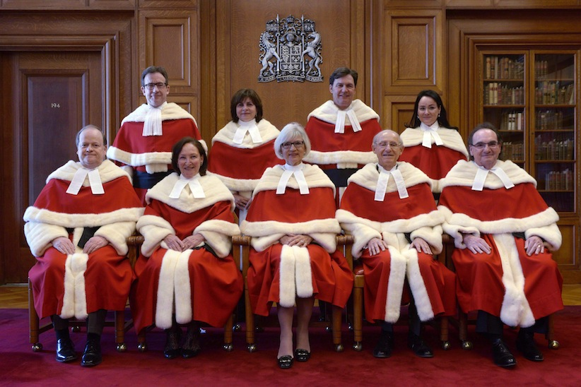 The Supreme Court justices pose for a group photo during the official welcoming ceremony for Supreme Court of Canada Justice Suzanne Cote at the Supreme Court, Tuesday Feb.10, 2015 in Ottawa. Do you want to be a Supreme Court justice? You may have a chance at a seat on the high court if you meet the requirements and criteria to be used in the new selection process. THE CANADIAN PRESS/Adrian Wyld