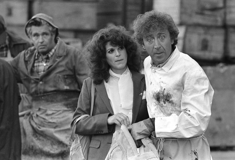 "In this Aug. 27, 1981 file photo, Gilda Radner, centre, and Gene Wilder, right, perform in a scene from the film ""Hanky Panky,"" directed by Sidney Poitier in Boston.  (AP Photo/Bill Polo, File)"