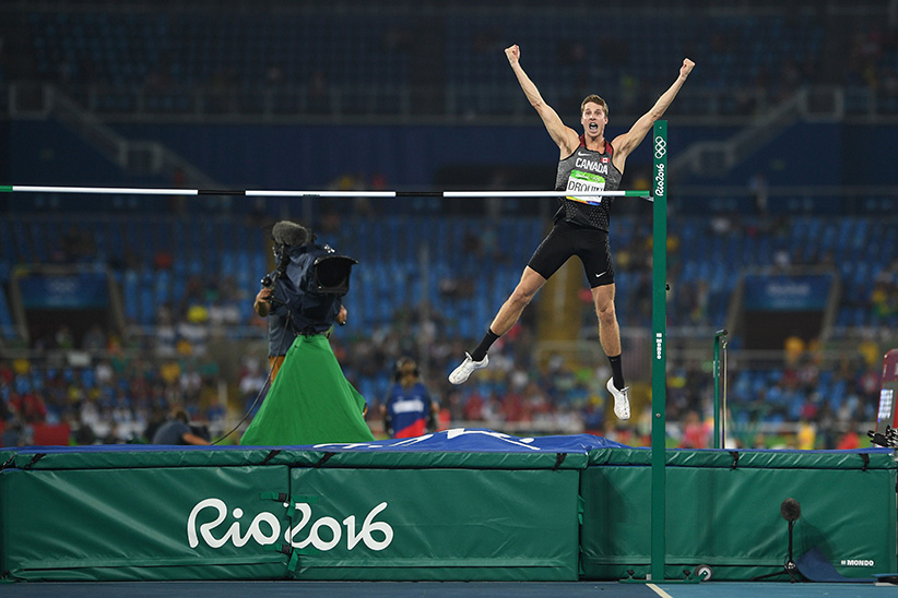 Canada's Derek Drouin celebrates winning the Men's High Jump Final during the athletics event at the Rio 2016 Olympic Games at the Olympic Stadium in Rio de Janeiro on August 16, 2016. (Johannes Eisele/AFP/Getty Images)