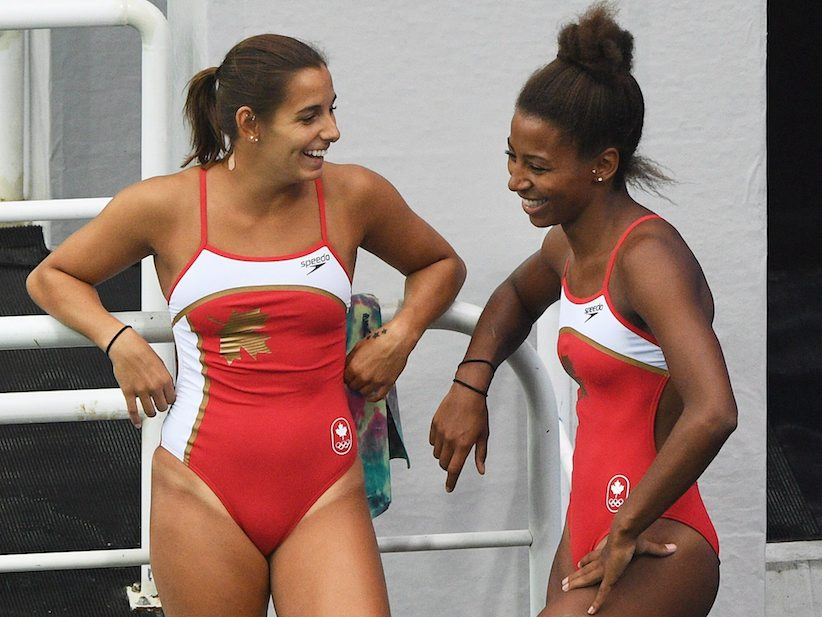 Pamela Ware, left, and Jennifer Abel, of Canada, share a laugh before they compete in the women's synchronized three-metre springboard diving final at the 2016 Olympic Games in Rio de Janeiro, Brazil on Sunday, Aug. 7, 2016. THE CANADIAN PRESS/Sean Kilpatrick