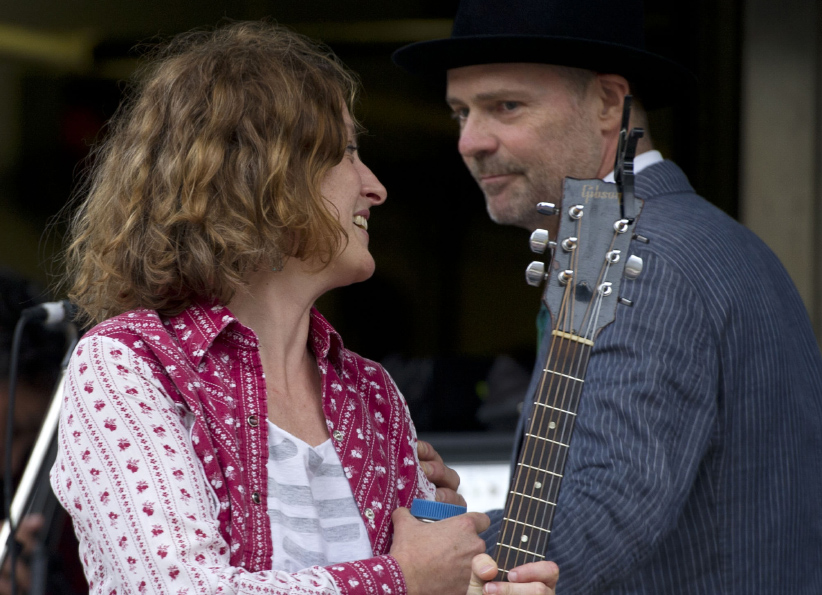 "Gord Downie congratulated Sarah Harmer after the musicians and there friends put on the ""Rock the Line"" concert to protest Enbridge's line 9 oil pipeline. (Lucas Oleniuk/Getty)"