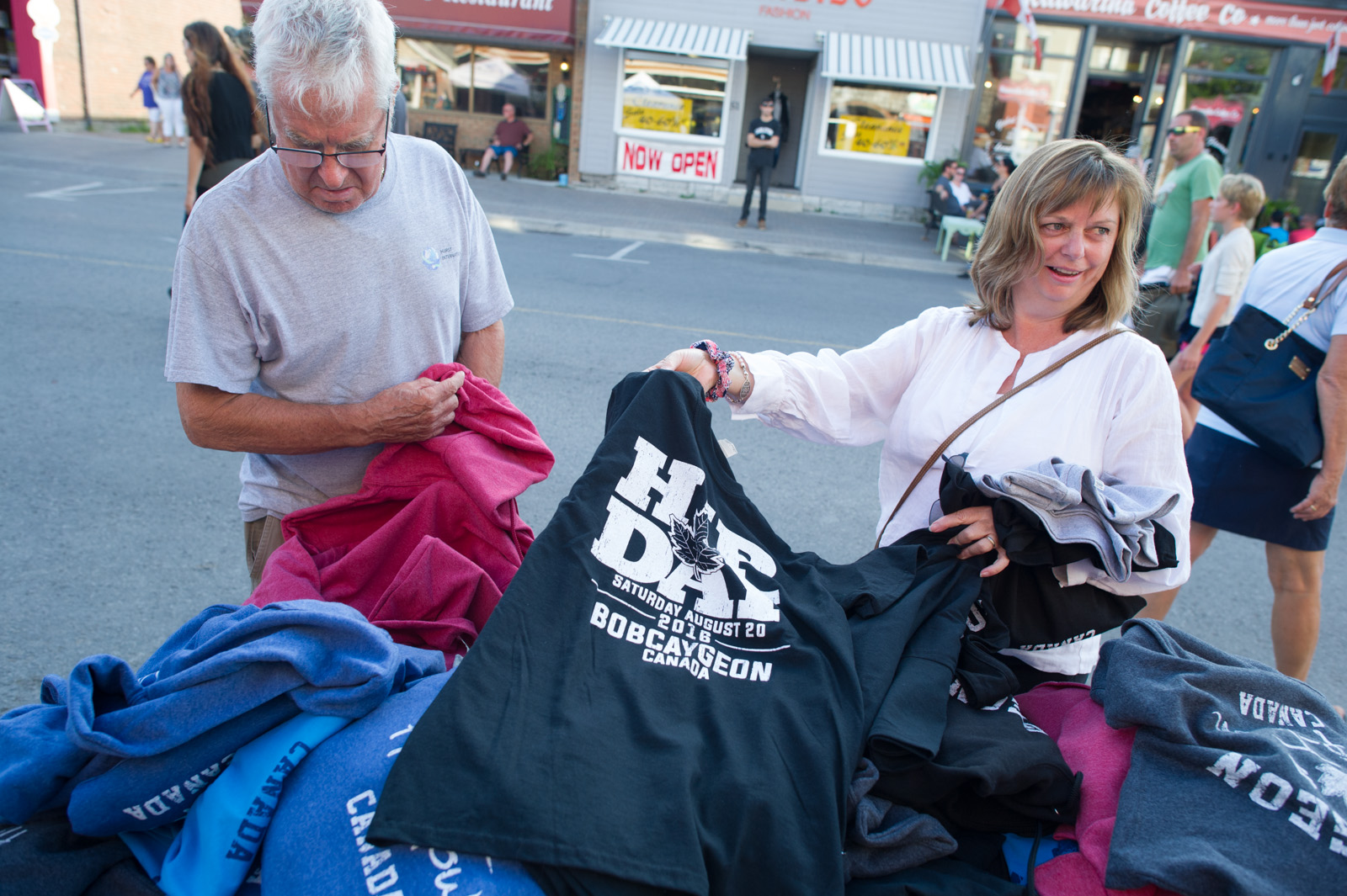 MACLEANS-BOBCAYGEON-08.20.16-Tragically Hip shirts are sold on Bolton street in downtown Bobcaygeon in anticipation for the live screening of the bands final concert.