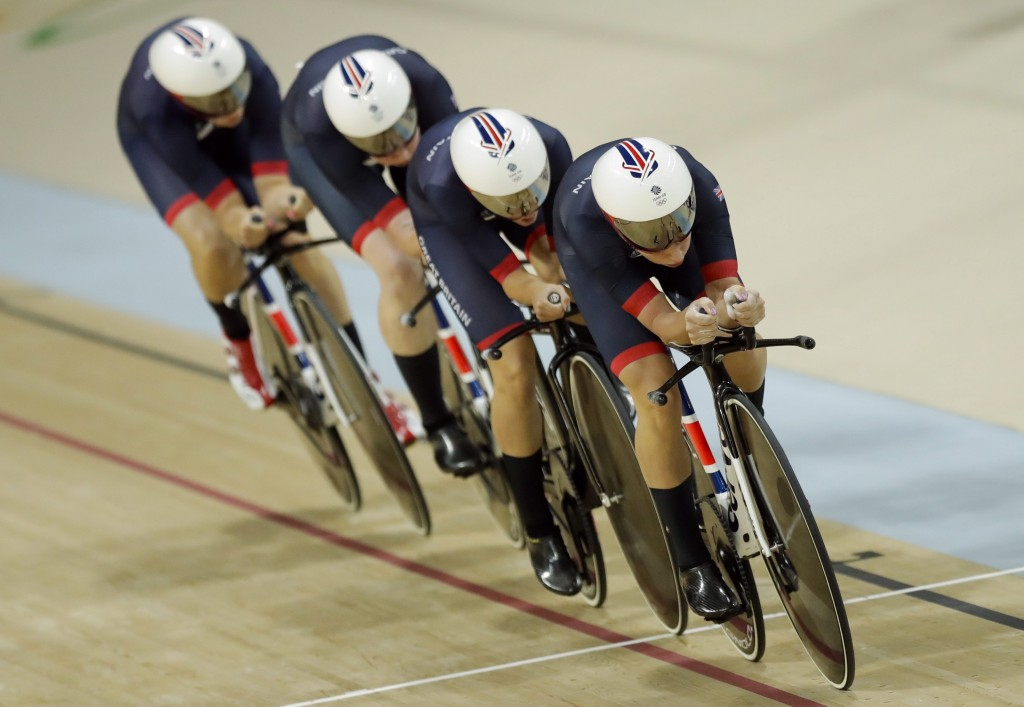 Britain's team race to win gold in the women's team pursuit finals cycling event at the Rio Olympic Velodrome during the 2016 Summer Olympics in Rio de Janeiro, Brazil, Saturday, Aug. 13, 2016. (AP Photo/Pavel Golovkin)