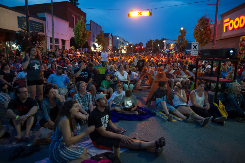 Tragically Hip fans gather on Bolton Street in Bobcaygeon. (Photograph by Cole Garside)