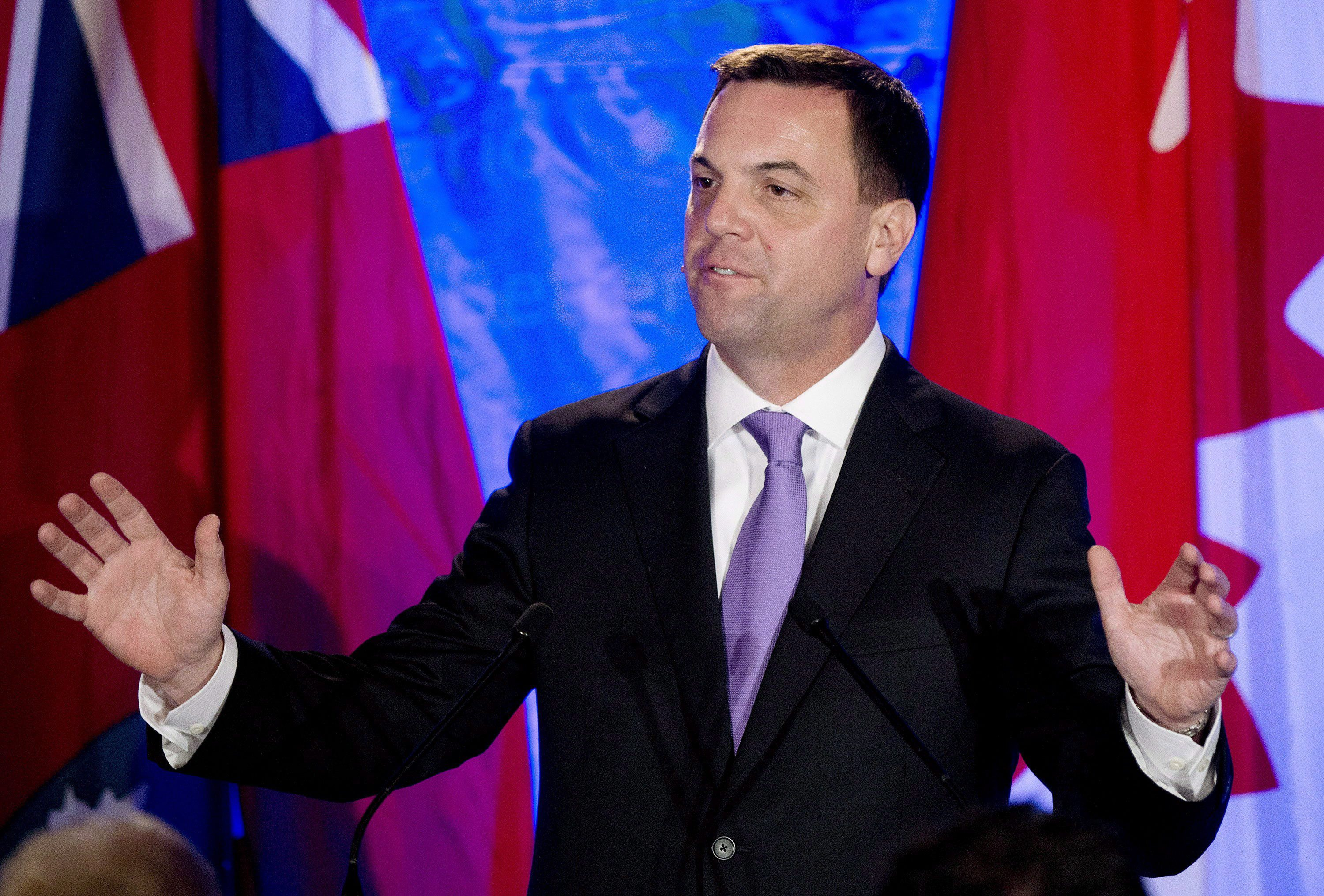 Ontario Progressive Conservative leader Tim Hudak announces that he will be stepping down as party leader after being defeated at his election night campaign head quarters in Grimsby, Ont., on Thursday, June 12, 2014. Hudak will resign his seat in the legislature next month and become CEO of the Ontario Real Estate Association. THE CANADIAN PRESS/Nathan Denette