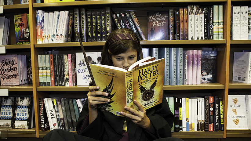 Amy Stocking reads from Harry Potter and The Cursed Child at the 12:01 launch of the book at Indigo (Bay and Bloor). Photograph by May Truong