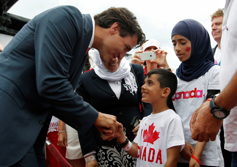 Canada's Prime Minister Justin Trudeau shakes hands with a Syrian refugee during Canada Day celebrations on Parliament Hill in Ottawa, Ontario, Canada, July 1, 2016. (Chris Wattie/REUTERS)