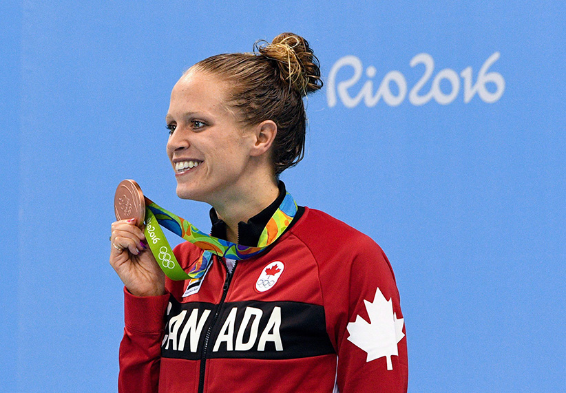 Canada's Hilary Caldwell celebrates bronze in the women's 200m backstroke finals during the 2016 Olympic Summer Games in Rio de Janeiro, Brazil on Friday, August 12, 2016. (Sean Kilpatrick/CP)