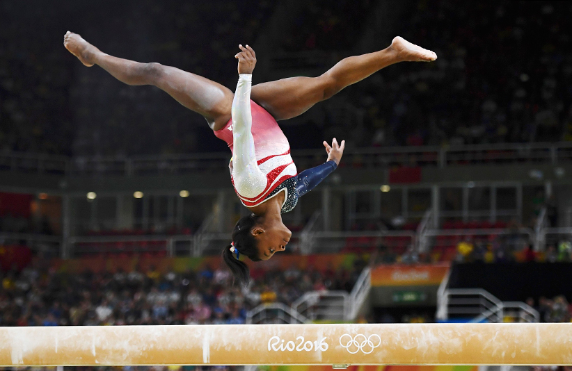 Smone Biles of USA competes on the beam during the women's team final on Tuesday. (Dylan Martinez/Reuters)