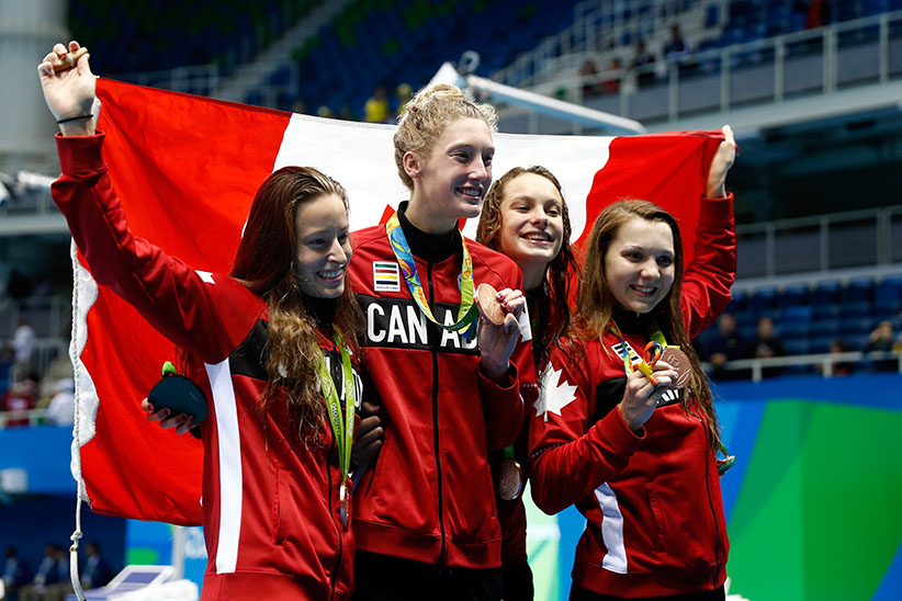 Bronze medalists Katerine Savard, Taylor Ruck, Brittany MacLean and Penny Oleksiak of Canada pose during the medal ceremony for the Women's 4 x 200m Freestyle Relay Final on Day 5 of the Rio 2016 Olympic Games at the Olympic Aquatics Stadium on August 10, 2016 in Rio de Janeiro, Brazil. (Clive Rose/Getty Images)