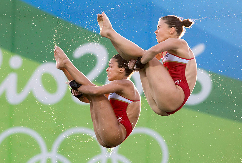 Canada's Meaghan Benfeito (left) and Roseline Filion perform a dive on their way to a bronze medal win in women's synchronized 10-meter platform diving at the 2016 Summer Olympics in Rio de Janeiro, Brazil, Tuesday, Aug. 9, 2016 (Frank Gunn/CP)
