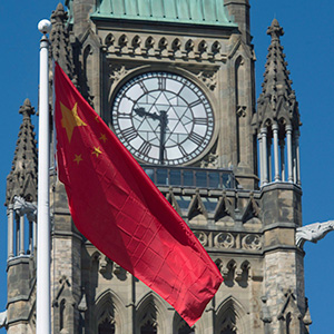 The Chinese flag flies on Parliament Hill as Chinese Foreign Minister Wang Yi meets on Parliament Hill in Ottawa, Wednesday June 1, 2016. (Adrian Wyld/CP)