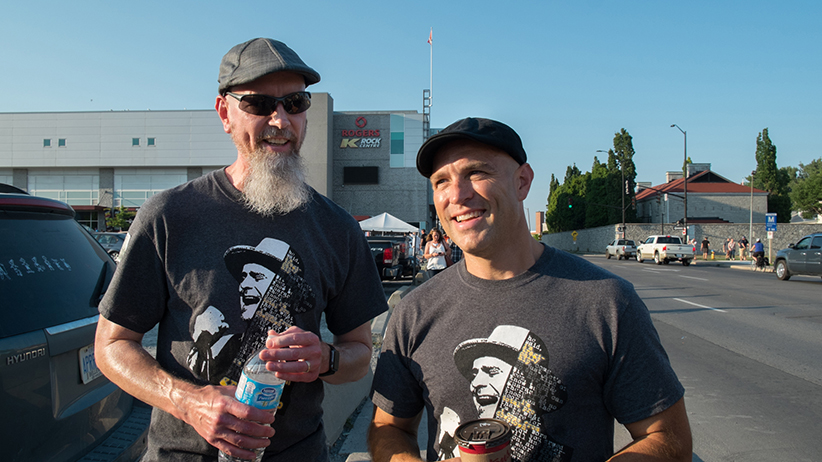 Fans of the Tragically Hip, Keith Johnson (left) and Jeff Johnson (right), wearing custom-made Tragically Hip T-shirts, on their way to the band's final performance at the K-Rock Centre in Kingston, ON August 20th 2016. (Photograph by J. Adam Huggins)
