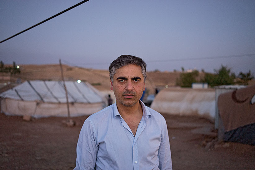 Payam Akhavan, law professor at McGill University at Yazidi refugee camp Khanke outside of Duhok, Iraq, July 26, 2016. (Photograph by Peter Bregg C.M.)