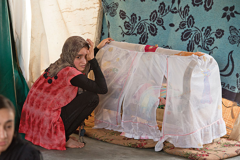Beshara Kader Ifas ( 15 years old) escaped from ISIS at Kabato Yazidi refugee camp outside of Duhok, Iraq, July 27, 2016. (Photogra[h by Peter Bregg C.M.)