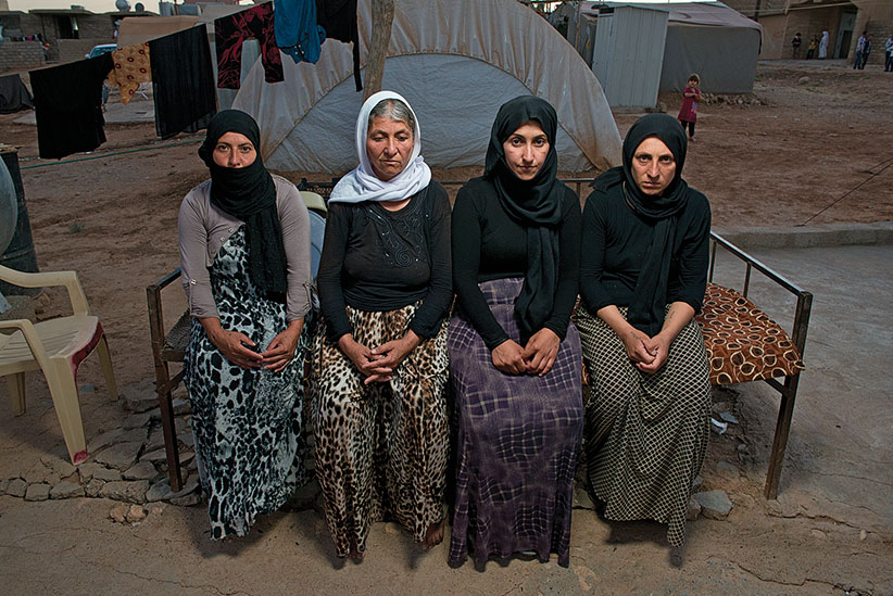 L-R Zatoon, Gaury, (Nadira) Markaz, 3 escapees from ISIS and one Nadira (2nd from right) ransomed, at Yazidi refugee camp Khanke outside of Duhok, Iraq, July 26, 2016. (Photograph by Peter Bregg C.M.)
