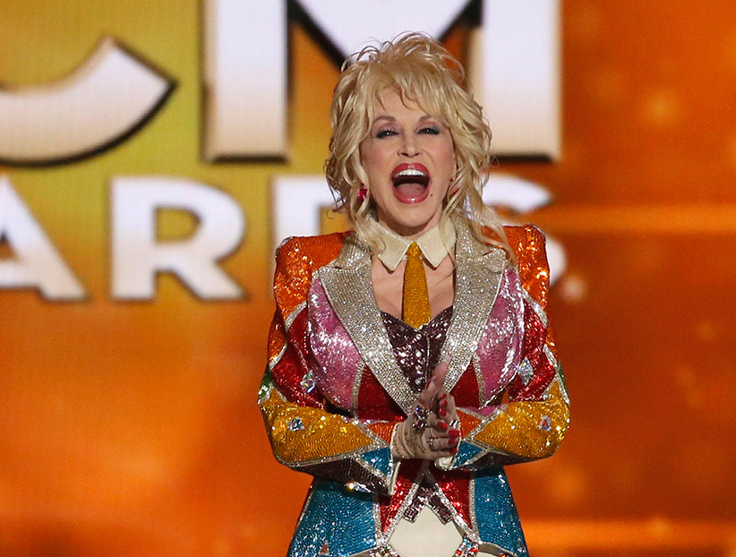 Dolly Parton takes the stage to accept the Tex Ritter Award at the 51st Academy of Country Music Awards in Las Vegas, Nevada April 3, 2016. (Mario Anzuoni/Reuters)