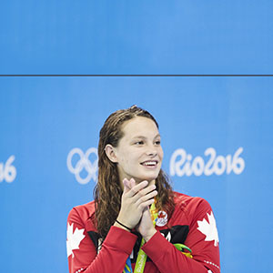 Canada's Penny Oleksiak shows her appreciation after winning a silver medal in the women's 100m butterfly at the 2016 Summer Olympic in Rio de Janeiro, Brazil. (Lucas Oleniuk/Toronto Star/Getty Images)