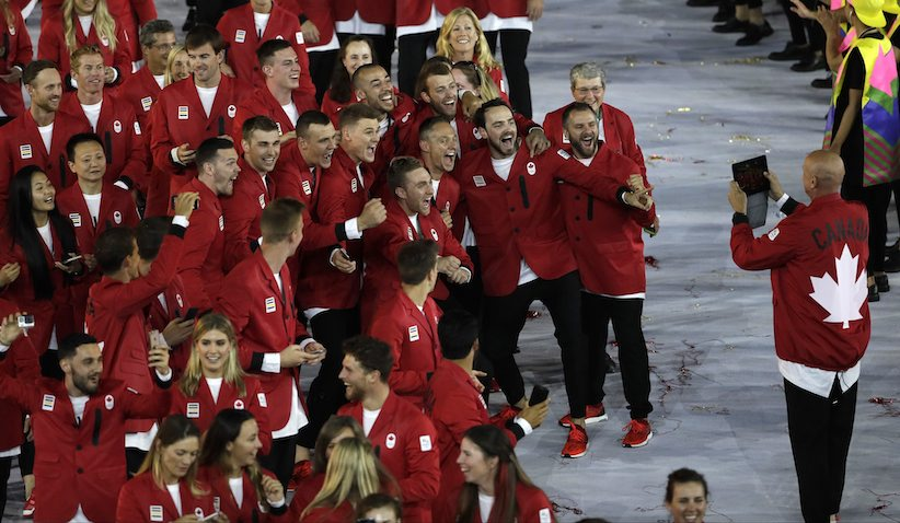 Canadian athletes pose for a photograph as they march in during the opening ceremony for the 2016 Summer Olympics in Rio de Janeiro, Brazil, Friday, Aug. 5, 2016. (AP Photo/Matt Slocum)