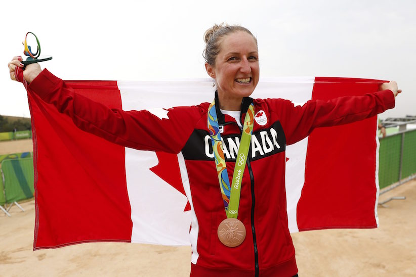 Bronze medalist Catharine Pendrel of Canada celebrates after the women's cross-country mountain bike race at the 2016 Summer Olympics in Rio de Janeiro, Brazil, Saturday, Aug. 20, 2016. (AP Photo/Patrick Semansky)