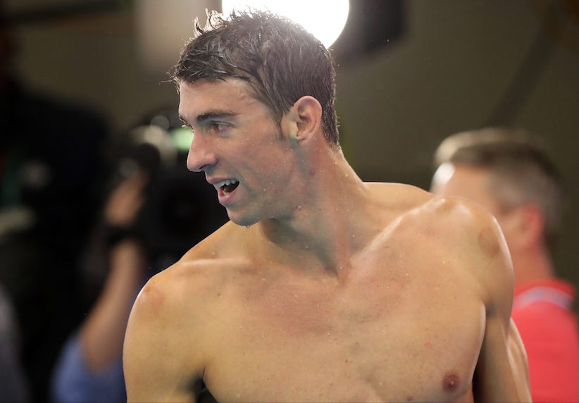 United States' Michael Phelps leaves the pool deck after his team won gold in the men's 4 x 100-meter medley relay final during the swimming competitions at the 2016 Summer Olympics, Saturday, Aug. 13, 2016, in Rio de Janeiro, Brazil. (AP Photo/Lee Jin-man)