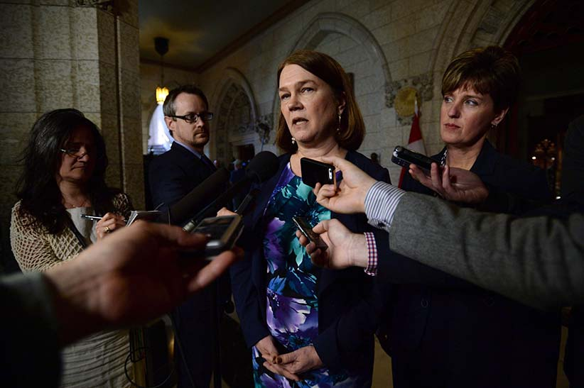 Minister of Health Jane Philpott and International Development Minister Marie-Claude Bibeau speak to reporters in the House of Commons foyer on Parliament Hill in Ottawa on Wednesday, May 11, 2016, regarding investments in the global fight against the Zika virus. (Sean Kilpatrick/CP)