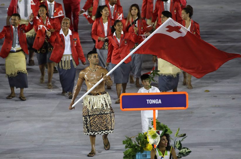 Pita Taufatofua carries the flag of Tonga during the opening ceremony for the 2016 Summer Olympics in Rio de Janeiro, Brazil, Friday, Aug. 5, 2016. (AP Photo/Matt Slocum)